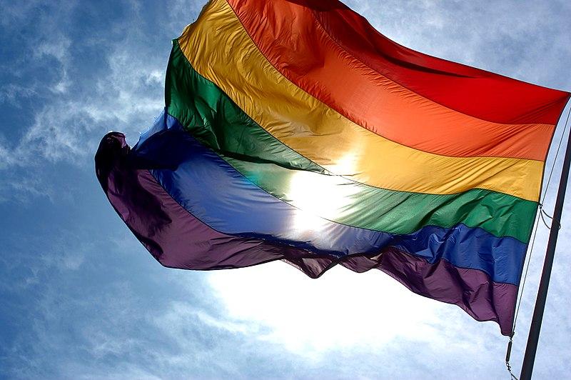 800px Rainbow flag and blue skies